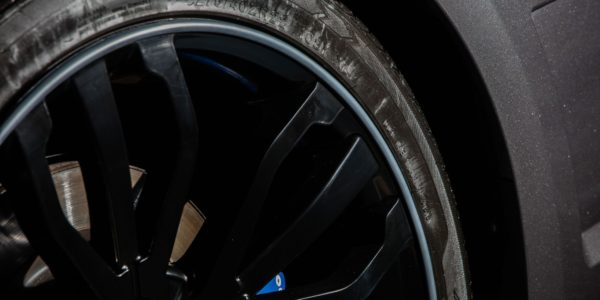 Close Up View Of Land Rover With Black Alloy Wheel, Graphite AlloyGator Wheel Rim Protector And Blue Calliper