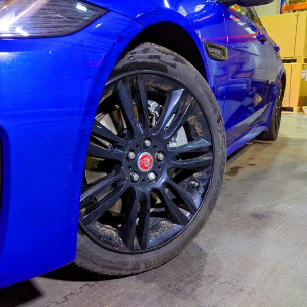 Black AlloyGator Wheel and Tyre Protection on Blue Jaguar